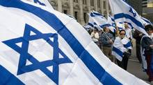 FILE PHOTO: Members of the Montreal Jewish community march to mark the 59th Independence Day of the State of Israel Tuesday, April 24, 2007 in Montreal. (Paul Chiasson/CP)