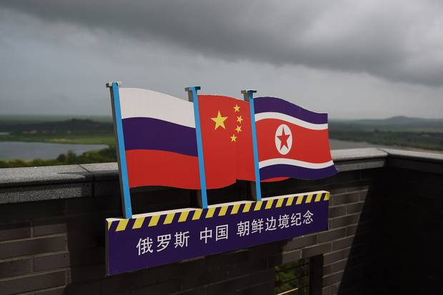 The flags of Russia, China and North Korea fly on a viewing tower on the border between the three countries in Hunchun, in China's northeast Jilin province.