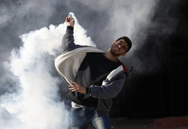 Palestinians clash with Israeli troops during a protest against U.S. President Donald Trump's decision to recognize Jerusalem as the capital of Israel in the West Bank City of Nablus on Dec. 7, 2017.