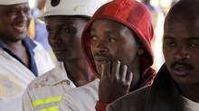 Miners return to work at the Lonmin platinum mine after Lonmin resolved a five-week strike by agreeing to pay raises of up to 22 per cent, in Marikana, Rustenburg, South Africa, Sept. 20, 2012. (DENIS FARRELL/AP)
