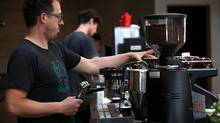 A barista at Sightglass Coffee makes a coffee drink in San Francisco. (Justin Sullivan/Getty Images)