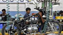 Workers assemble a Royal Enfield motorcycle in the southern Indian city of Chennai, April 6, 2012. India's central bank last week published an unusually sharp academic critique of New Delhi's economic mismanagement. (Babu/Reuters/Babu/Reuters)