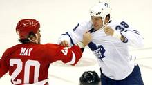Toronto Maple Leafs Jay Rosehill, right, and Detroit Red Wings Brad May fight during the second period of their NHL preseason hockey game in Detroit, Michigan, September 25, 2009. (REBECCA COOK)
