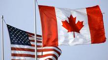 The United States flag and the Canadian flag fly side by side at the Walden Galleria Mall in Cheektowaga, N.Y. (David Duprey/David Duprey/AP)