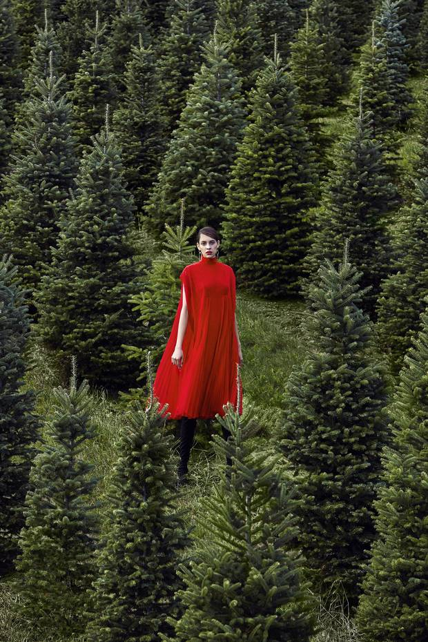 Signature Valentino rouge stands out in a forest of evergreens – or a roomful of LBDs. Valentino dress, price on request at Holt Renfrew (www.holtrenfrew.com). Boots, $129 at Zara (www.zara.com). Alta Ora earrings, $200 each through @altaora on Instagram.
