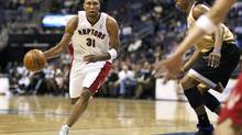 Toronto Raptors forward Shawn Marion drives with the ball against the Washington Wizards Caron Butler during their NBA basketball game in Washington, DC, Monday night. (Joshua Roberts/Reuters)