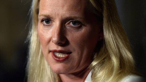Minister of Environment and Climate Change Catherine McKenna responds to the Spring Report from the Commissioner of the Environment and Sustainable Development during a media availability in the foyer of the House of Commons on Parliament Hill in Ottawa on Tuesday, May 31, 2016. McKenna says the federal government is prepared to impose a price on carbon on any province that can't come up with their own, or a cap and trade system.
