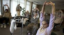 Mrs. Saroj Sood, 92, participates in an exercise class at her retirement home in Surrey, British Colombia on February 12th, 2009 (Simon Hayter For the Globe and Mail)