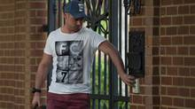 Carl Pistorius, brother of Olympian athlete, Oscar Pistorius, arrives at home, Sunday Feb. 24, 2013, where his brother has been staying in Pretoria, South Africa, since being granted bail Friday for the Valentine's Day shooting death of his girlfriend, Reeva Steenkamp. Reports emerged Sunday that Carl Pistorius is facing charges of culpable homicide for the death of a female motorcyclist. (Str/AP)