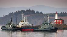 A vessel carrying 490 suspected Tamil asylum seekers makes its way into CFB Esquimalt near Victoria on Aug. 13, 2010. (John Lehmann/Globe and Mail)