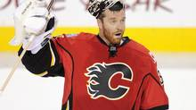 Calgary Flames goalie Miikka Kiprusoff, from Finland, salutes the crowd after a 2-1 victory over the Anaheim Ducks after NHL action in Calgary, Alberta, Friday, April 19, 2013. It is speculated that this will be his last home game. (Larry MacDougal/THE CANADIAN PRESS)