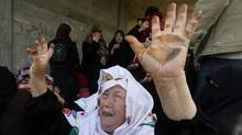 Palestinians women react during the funeral of 12 year old Ayoub Assalya killed in an Israeli airstrike in Jabaliya Refugee Camp, in Gaza Strip, Sunday, March 11, 2012. The worst round of violence in more than a year between Israel and Gaza Strip Palestinians deepened Sunday with deadly Israeli airstrikes and a barrage of rockets fired into the Jewish state (Hatem Moussa/AP/Hatem Moussa/AP)