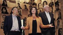 Melinda Gates speaks to the media while her husband, Microsoft co-founder Bill Gates (L) and his father William H. Gates Sr. listen during an advanced tour of the newly constructed $15 million visitor center at the Bill and Melinda Gates Foundation $500 million campus in Seattle, Washington February 1, 2012. (ANTHONY BOLANTE/REUTERS)