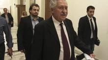 Leader of Democratic Left party Fotis Kouvelis, centre, arrives at the Greek parliament Oct. 23, 2012. His party has rejected austerity measures demanded by international lenders. (JOHN KOLESIDIS/REUTERS)