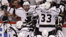 Los Angeles Kings players celebrate after winning the Western Conference finals against the Phoenix Coyotes May 23, 2012. (Ross D. Franklin/Associated Press)