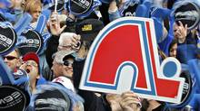 People attend the Blue March rally on the Plains of Abraham in support of bringing an NHL franchise back to Quebec City on Oct. 2, 2010. (MATHIEU BELANGER/REUTERS)