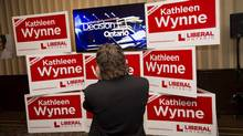 A man watches results of the Ontario provincial election on a television at the Liberal party's election night headquarters in Toronto on Thursday, June 12, 2014. (Darren Calabrese/THE CANADIAN PRESS)