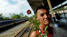 A Red Shirt supporter waits for fellow anti-government protesters at a train station in Chiang Mai, Thailand, on Friday, May 21. (Manan Vatsayana/AFP/Getty Images)