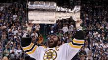 Boston Bruins' Zdeno Chara, of Slovakia, hoists the cup following his teams win over the Vancouver Canucks in game 7 of NHL Stanley Cup Final hockey at Rogers Arena in Vancouver, Wednesday, June 15, 2011. THE CANADIAN PRESS/Jonathan Hayward (JONATHAN HAYWARD/Jonathan Hayward/The Canadian Press)