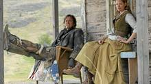 Paul Gross and Sienna Guillory kick back on the porch in Gunless.