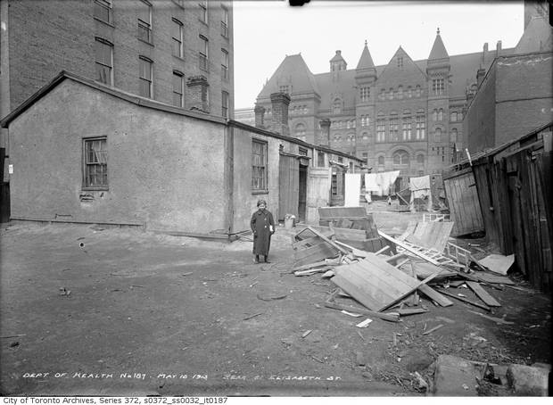 On May 15, 1913, the photographer Arthur Goss chronicled impoverished conditions in St. John's Ward, including this photo, of a girl standing beside a tumbled down house with the old city hall in the background, has fascinated for years. Using an old street map, assessment records and a genealogy service, she has been identified as Dorothy Cooperman, born in Kiev around 1902, died in Michigan in 1979.