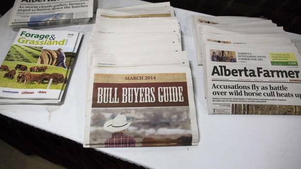 Agricultural publications line a table during the 114th annual Calgary Bull Sale. (TODD KOROL/REUTERS)