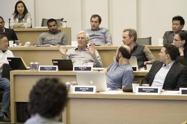 Canadian venture capitalist Haig Farris, centre, provides feedback at a Creative Destruction Lab session.