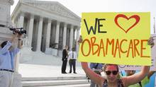 Supporters of the Affordable Healthcare Act gather in front of the Supreme Court before the court's announcement of the legality of the law in Washington on June 28, 2012. (Joshua Roberts/Reuters)