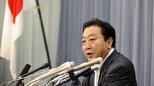 Japanese Finance Minister Yoshihiko Noda announces a $100-billion facility to help ease the impact of the strong yen on Japanese companies at a press conference at his office in Tokyo on Aug. 24, 2011. (Yoshikazu Tsuno/AFP/Getty Images)