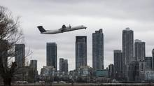 A Porter Airlines plane take off from Toronto's Billy Bishop Airport in front of condo towers on Wednesday April 10, 2013. (Chris Young for The Globe and Mail)