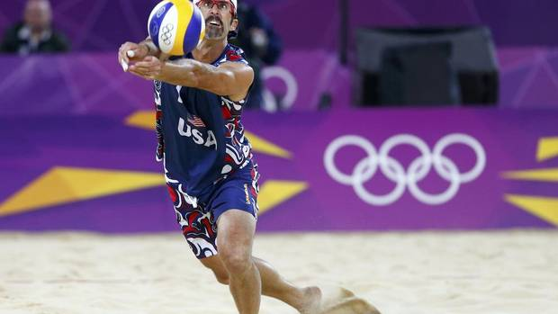 Todd Rogers of the U.S. digs the ball against Czech Republic's Premysl Kubala and Petr Benes during their men's preliminary round beach volleyball match at Horse Guards Parade during the London 2012 Olympic Games August 2, 2012. (DOMINIC EBENBICHLER/REUTERS)