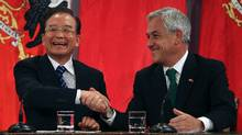 Chile's President Sebastian Pinera (R) and China's Premier Wen Jiabao shake hands at the Presidential Palace in Santiago, June 26, 2012. Wen is in Chile for the last leg of his official visit to Latin America. (Reuters)