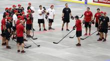 Head coach Mike Babcock, from Saskatoon, Sask., gives instruction during a ball hockey training session at the Canadian national men's team orientation camp in Calgary, Alta., Monday, Aug. 26, 2013. (Jeff McIntosh/THE CANADIAN PRESS)