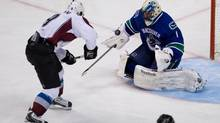 Vancouver Canucks' goalie Roberto Luongo, right, stops Colorado Avalanche's Matt Duchene on a breakaway during the third period of an NHL game in Vancouver, B.C., on Wednesday January 30, 2013. (DARRYL DYCK/THE CANADIAN PRESS)