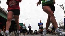 Runners on Toronto's Lakeshore Boulevard during the Scotiabank Waterfront Marathon. (Michelle Siu for The Globe and Mail)