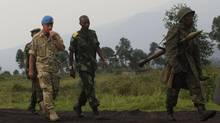 A UN Deputy Force Commander in Congo visits the area were M23 rebels fought with Congo government troops close to the eastern city of Goma on July 29, 2012. (JAMES AKENA/REUTERS)