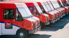 Canada Post vehicles sit outside a sorting depot in the Ville St-Laurent borough of Montreal, in a June 6, 2011 photo (Graham Hughes/THE CANADIAN PRESS)