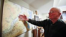 D-Day veteran Lance Cpl. John Ross, 93, looks over a map at his home in Lethbridge, Alta., on May 28. (Jeff McIntosh/THE CANADIAN PRESS)