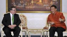 Canadian Finance Minister Jim Flaherty meets his Thai counterpart Kittirat Na Ranong in Bangkok March 27, 2013. (REUTERS)