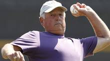Baseball Hall of Famer Pat Gillick throws out the ceremonial first pitch in the Philadelpia Philies spring training baseball game against the Toronto Blue Jays at Florida Auto Exchange Stadium in Dunedin, Fla., Tuesday, March 22, 2011. (AP Photo/Kathy Willens) (Kathy Willens)