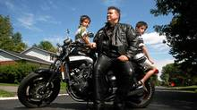 Paul Poirier with his sons Benny (L) and Zack (R). (Dave Chan for The Globe and Mail)