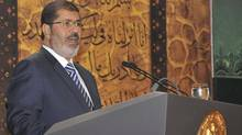 Egypt's President Mohamed Morsi speaks at the Al-Azhar Conference Centre in Cairo on August 12, 2012. (H/O/REUTERS)