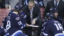 Winnipeg Jets head coach Paul Maurice talks with Bryan Little (18) during first period NHL action against the New York Rangers in Winnipeg on Friday, March 14, 2014. (The Canadian Press)