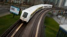 A SkyTrain commuter train travels into downtown Vancouver, B.C., on Wednesday April 11, 2012. (Darryl Dyck for The Globe and Mail/Darryl Dyck for The Globe and Mail)