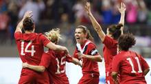 Christine Sinclair (12) of Canada celebrates her goal against Mexico with teammates during the first half of their semi-final CONCACAF Women's Olympic qualifying soccer match in Vancouver, British Columbia January 27, 2012. (BEN NELMS/REUTERS)