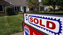 A sold sign is posted outside a recently sold home in Springfield, Ill. in this file photo. (Seth Perlman/AP)