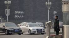 A paramilitary police officer stands guard next to Audi cars at the Great Hall of the People in central Beijing on Feb. 29, 2012. Audi's have become the car of choice for China's leaders. (ZHEYANG SOOHOO/ZHEYANG SOOHOO/REUTERS)