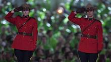 Mounties saluting during the Paralympic Opening Ceremonies in Vancouver March 12, 2010. (John Lehmann/The Globe and Mail/John Lehmann/The Globe and Mail)