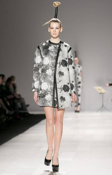 For a designer who works predominantly in black, fall was an optimistic – even romantic – departure for Neigum. His striking dark rose print, which worked best on the cocoon coat shown here, added buoyancy to his post-apocalyptic collection. (Jenna Marie Wakani)