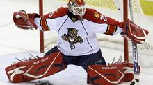 Florida Panthers goalie Tomas Vokoun, of the Czech Republic, makes a first-period save during an NHL hockey game against the Pittsburgh Penguins in Pittsburgh, Friday, Oct. 23, 2009. (Gene J. Puskar)